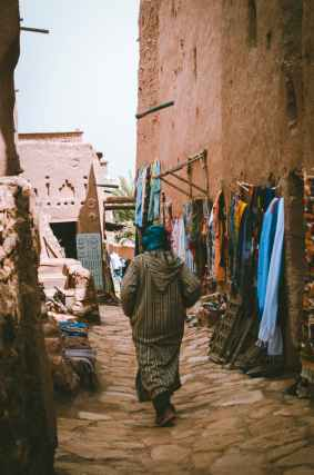 photo of a woman passing through the alley