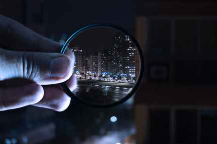 person holding magnifying glass