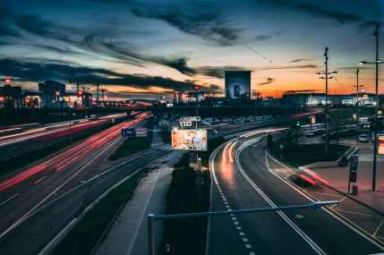 time lapse photography of road during golden hour