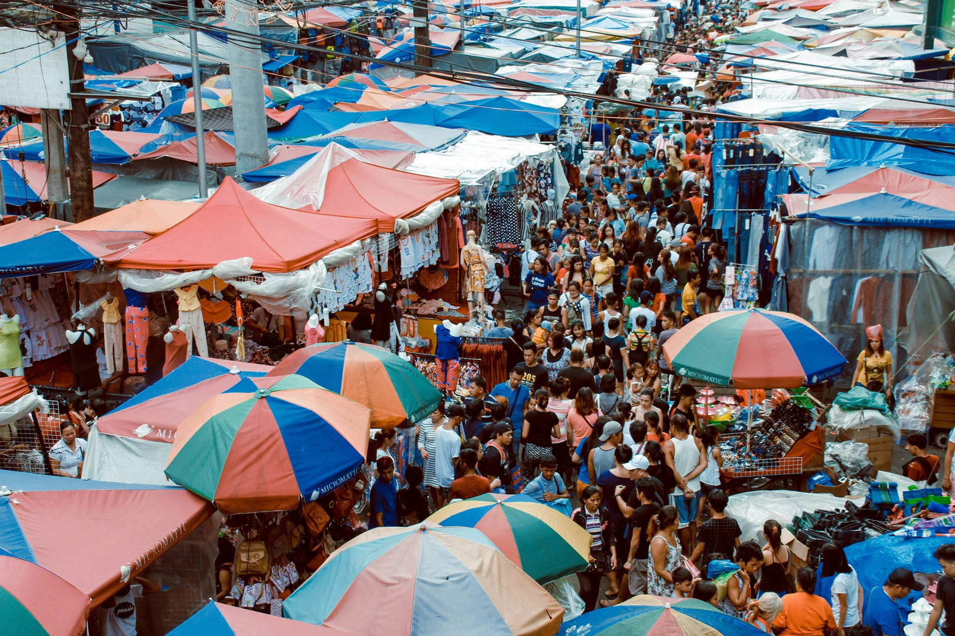 photo of crowd of people in the market