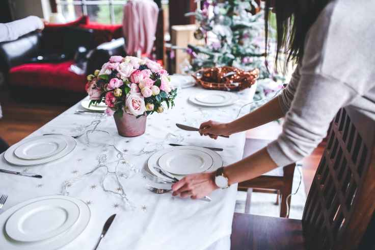 woman preparing christmas table