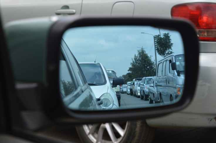 car side mirror showing heavy traffic