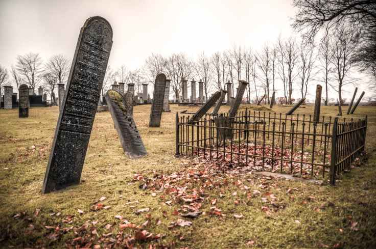 photography of graveyard under cloudy sky