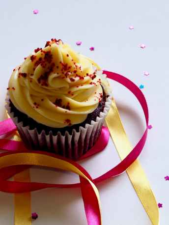 chocolate cupcake with white and red toppings